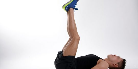 fit-man-lying-on-back-doing-leg-exercises
