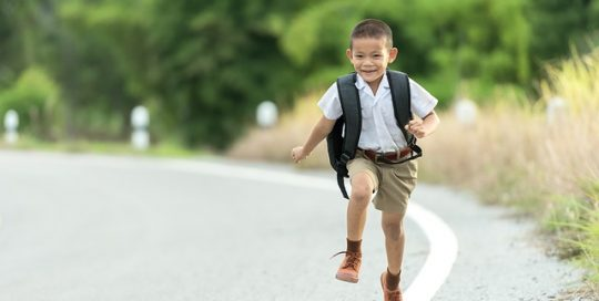 Young-boy-going-back-to-school-excited-jumping