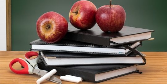 apples-and-books-on-table