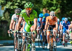 men-cycling-in-road-race
