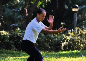 man-in-park-practicing-tai-chi-for-energy