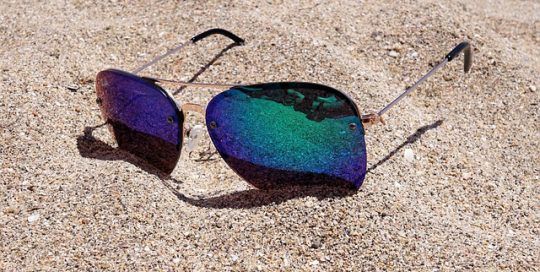 sunglasses-on-sandy-beach