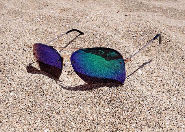 sunglasses-on-sandy-beach