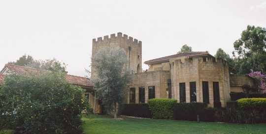 castle-on-a-property-with-grassy-lawn