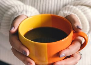 woman-holding-hot-cup-of-coffee