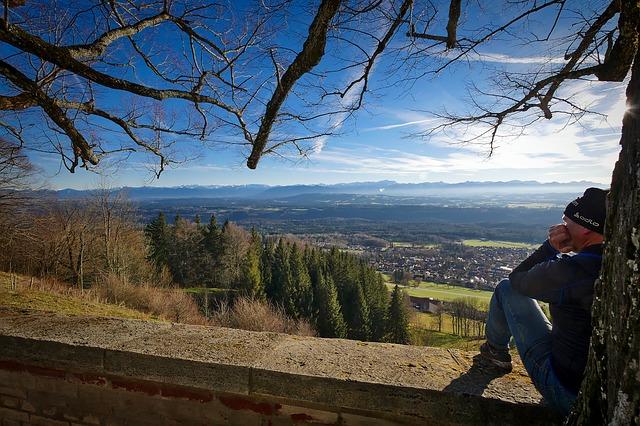 man-sitting-beside-tree-lovely-countryside-scene
