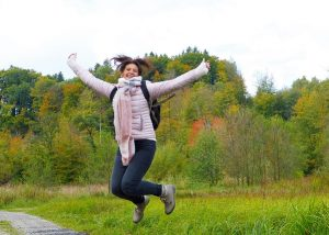 happy-woman-jumping-in-the-forest